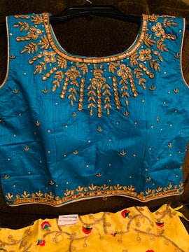 Organza Silk Lehanga with embroidery and stones , jardosi and kundan work blouse