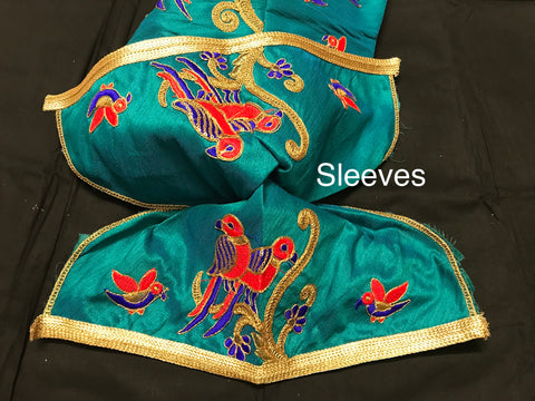 Green color Silk Designer blouse with embroidery and beads work