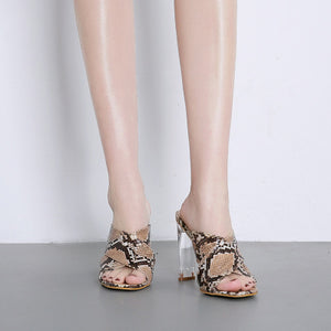 Snakeskin glass slippers and sandals