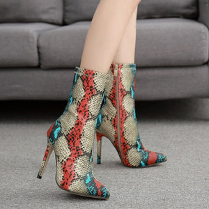Serpentine pointed mid-tube boots with thin heels