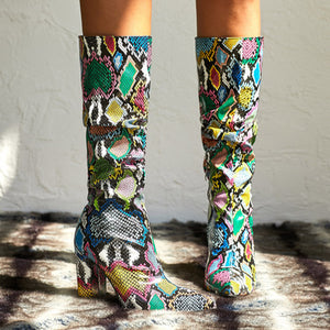 Serpentine pointed lace-up boots