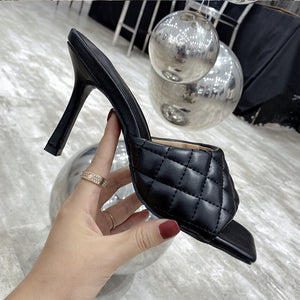 Fashionable stiletto slippers