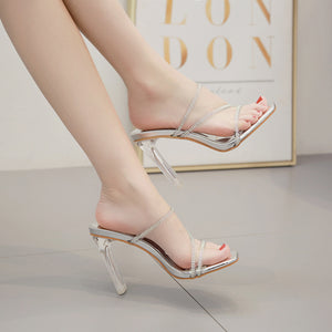 One word with diamond club a stiletto heel sandals