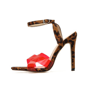 Cross-lettered PVC stiletto sandals in candy color