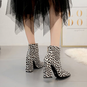 White leopard-print ankle boots with square roots and pointed toes