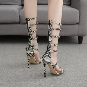 High heel sandals with thin snakelike perforations