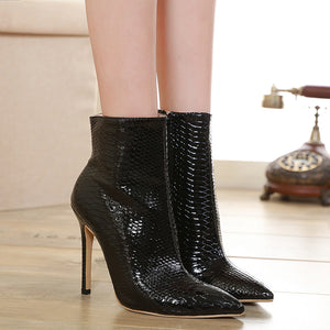 Serpentine ankle boots with high heels