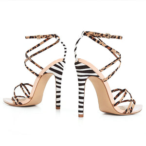 TAI NUDE LEOPARD AND ZEBRA STRAPPY HEELS