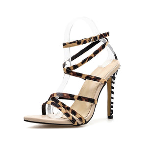 Pointy zebra print cross strap gladiator sandals
