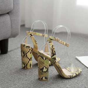 Word with PVC snake pattern high heel thick heel sandals