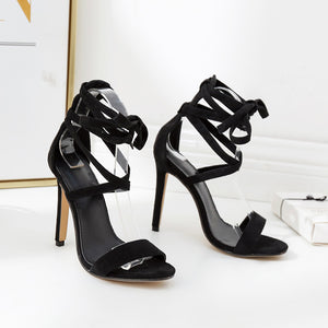 Show thin ringed cross-strap open-toe sandals