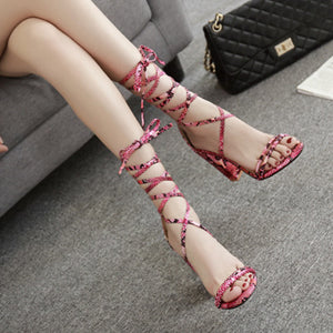 Serpentine strappy sandals with thick heels
