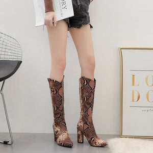 Serpentine boots with thick heels