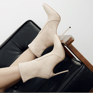Stylish high - heeled boots with pointed toes