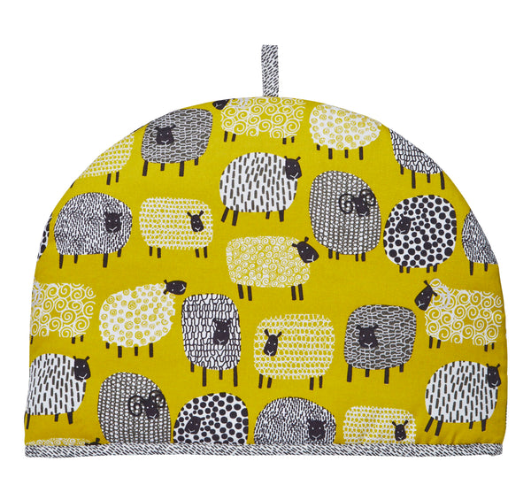 Mrs Doyle's Sheep Tea Cosy features lots of quirky Dotty Sheep illustrations on a mustard background