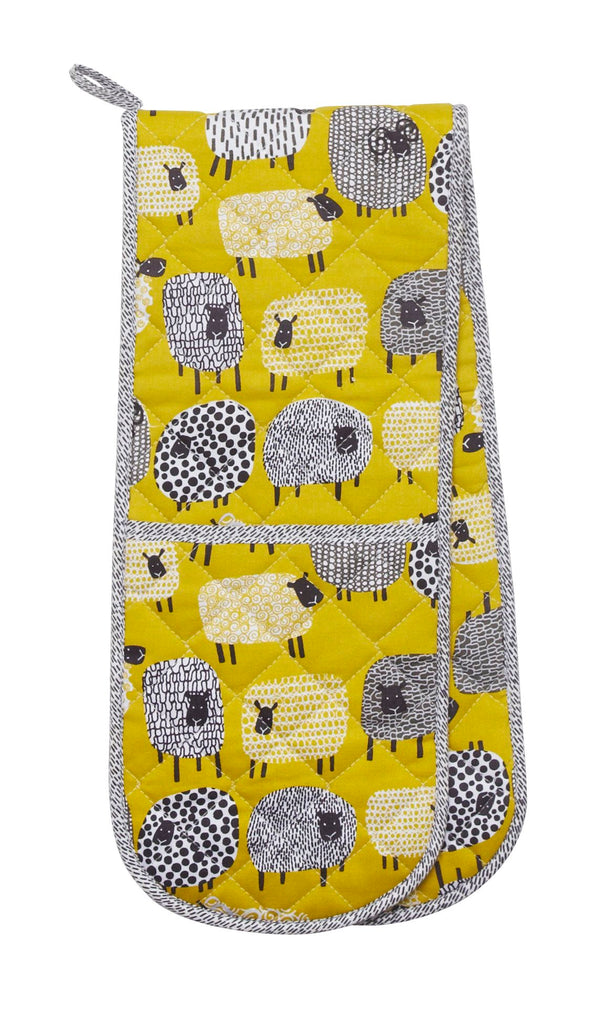Mrs Doyle's Sheep Oven Gloves has a dotty sheep design with sheep illustrations on mustard background, this is a double glove It's made from 100% cotton with polywadding filling for protection.