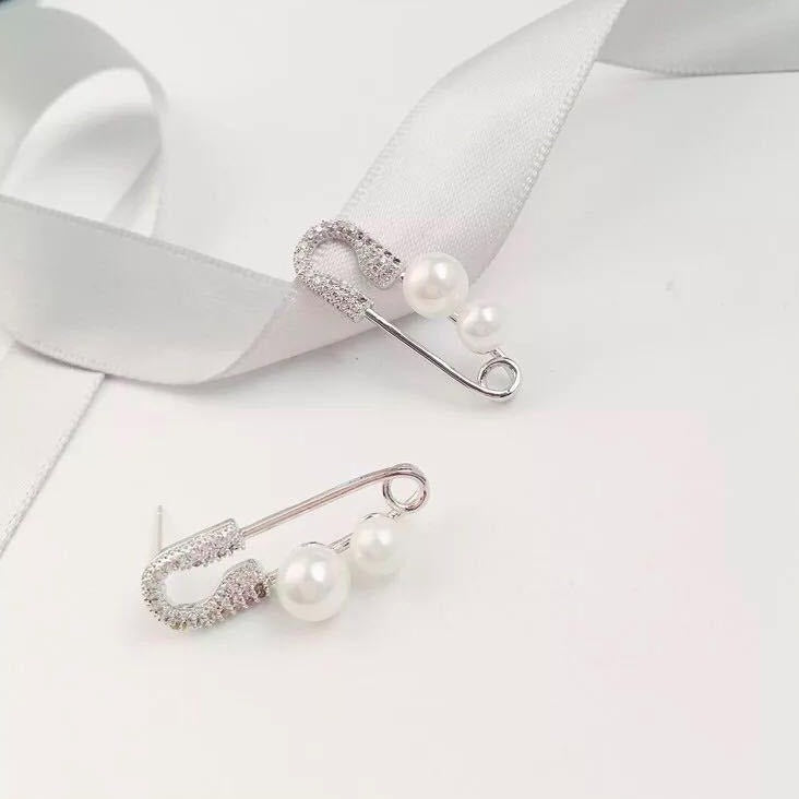 Silver Pin Ear Stud With Pearl Deco