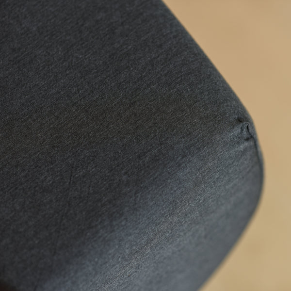 close-up on the corner of a bamboo charcoal fitted sheet in charcoal grey colour