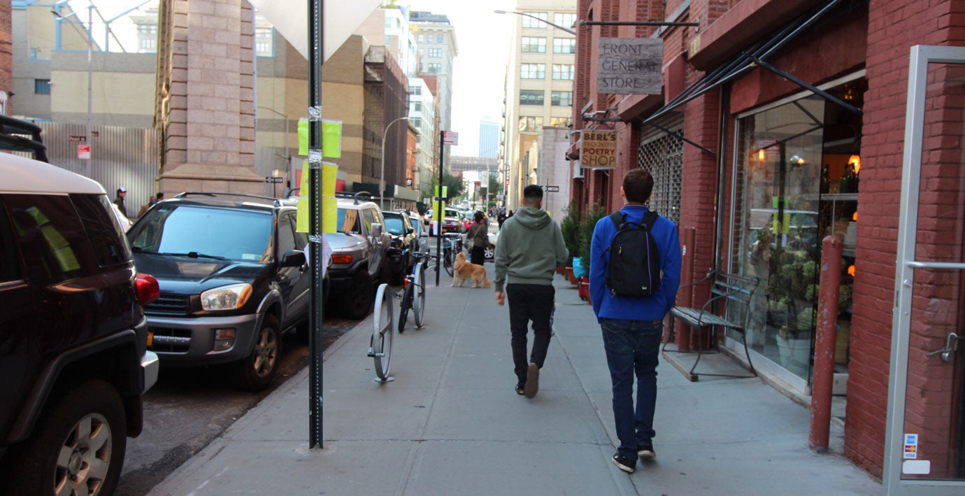 scene of new york city street with people walking