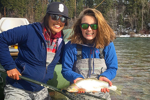Woman fly fishing with her daughter.