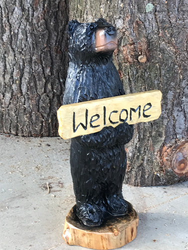 Black Bear Holding Welcome Sign