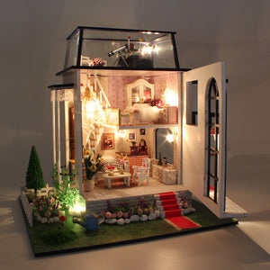 lighted white wooden dollhouse with front cover open