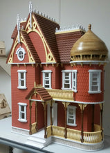red painted wooden dollhouse mansion kit side view