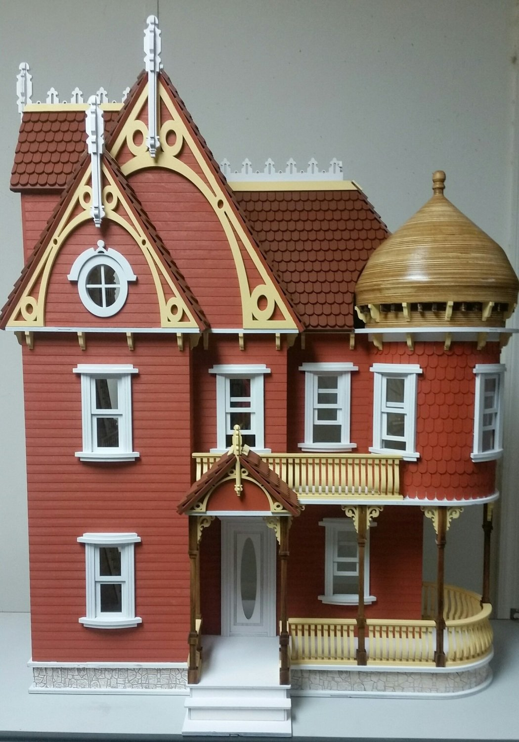red painted wooden dollhouse mansion kit front view