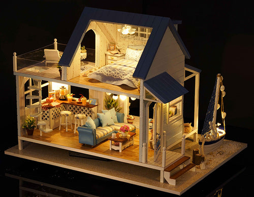 beach cottage dollhouse kit with light on and sailboat
