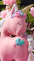 Coral Fleece Unicorn with Turquoise Heart Embellishment