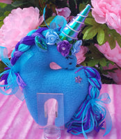 Small Turquoise Unicorn with Purple Flower Embellishments