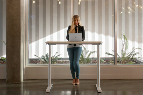 Employee using a standing desk