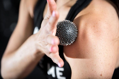Women Using Aku Ball for Shoulder acupunture points - Image
