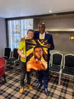 Frank Bruno holding his Portrait Painting, special celebrity portraits by Jim Kook