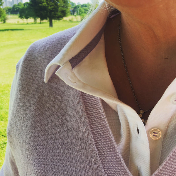 Ladies polo shirt in white & lilac