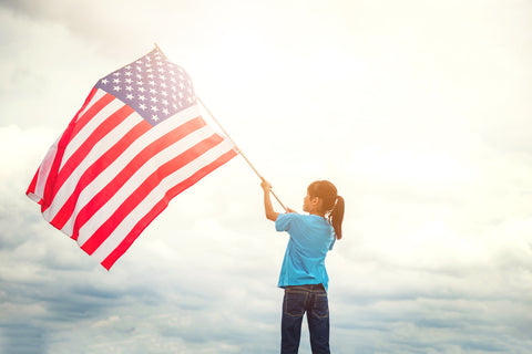 kid holding an american flag