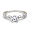 Round-Cut Solitaire With Accents Diamond Engagement Ring