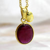 "Oval Simulated Ruby Charm Pendant 30"" Chain"