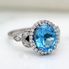 Natural Sky Blue Topaz Oval Halo Engagement Ring