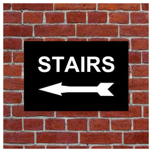 Stairs with left arrow sign or sticker