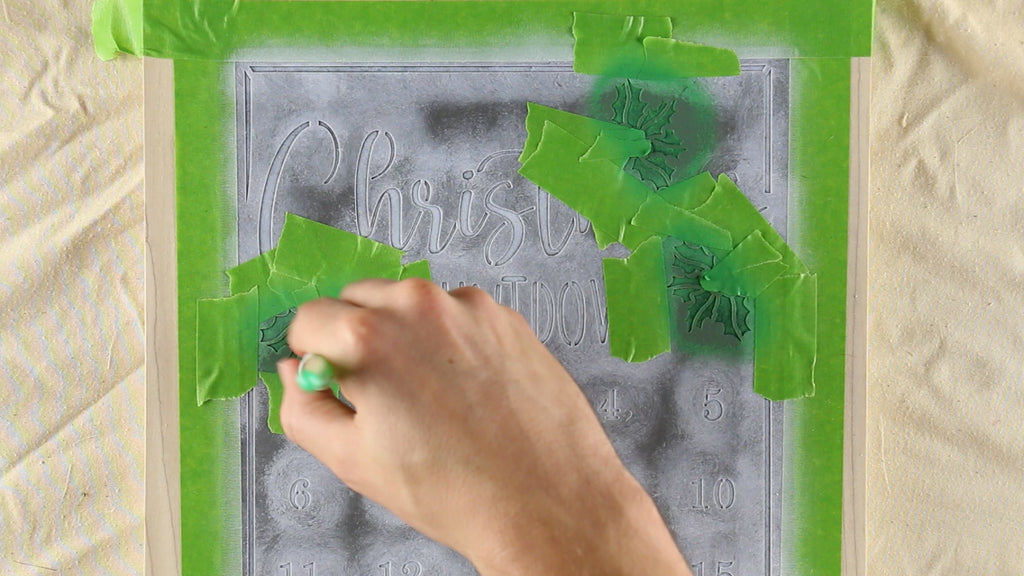Then mask off and stencil your holly leaves