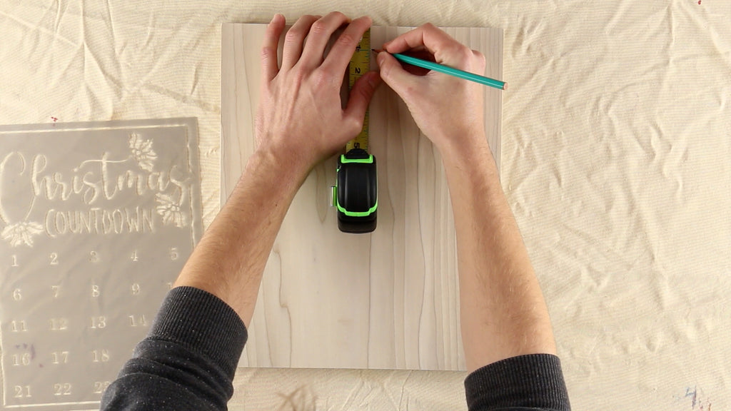 Use a pencil to make small dots along the top and side of the wood