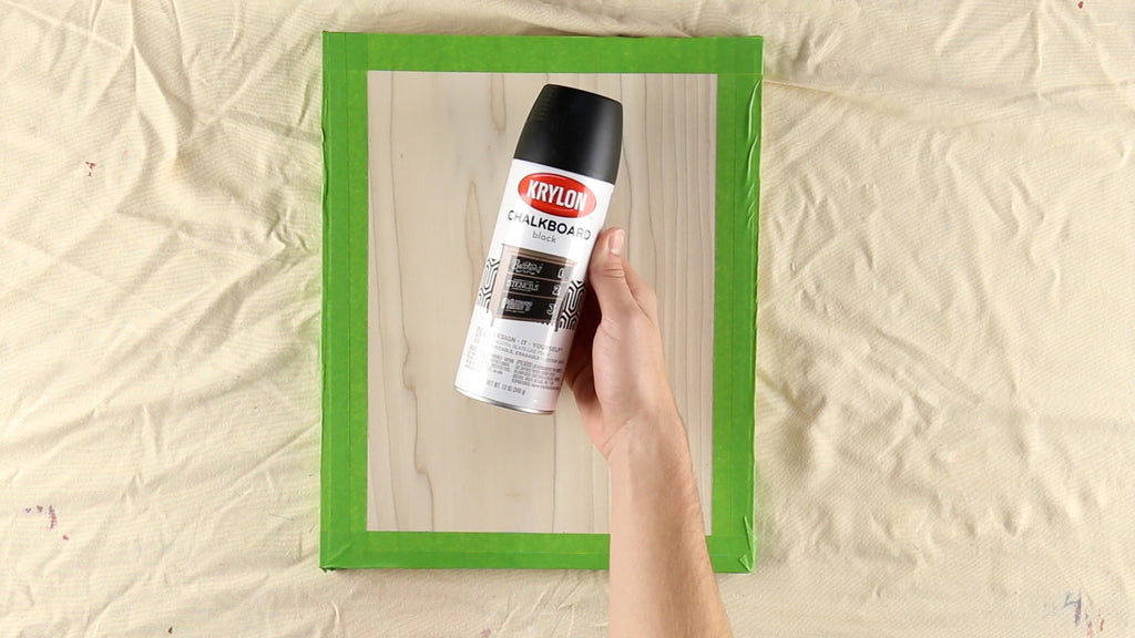 Mask off the edges and coat the wood in Krylon Chalkboard Spraypaint