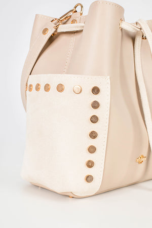 Close-up of the white bag with golden details