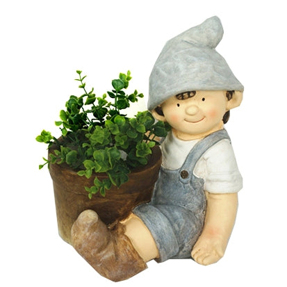 Boy With Pointed Hat Sitting Beside Planter