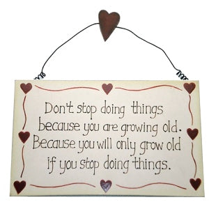 'Don't Stop Doing Things Because You Are Growing Old' Wood Plaque
