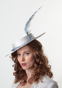 Model wearing Amherst feather Pale blue and white Boater Hat. Handmade Millinery made in London.  Side view.