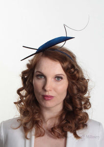Navy two quill headband or fascinator on Model. Front view. Handmade millinery made in London.