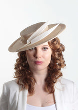 Harper natural and cream boater with two quills. Millinery handmade in London. Front view with model.