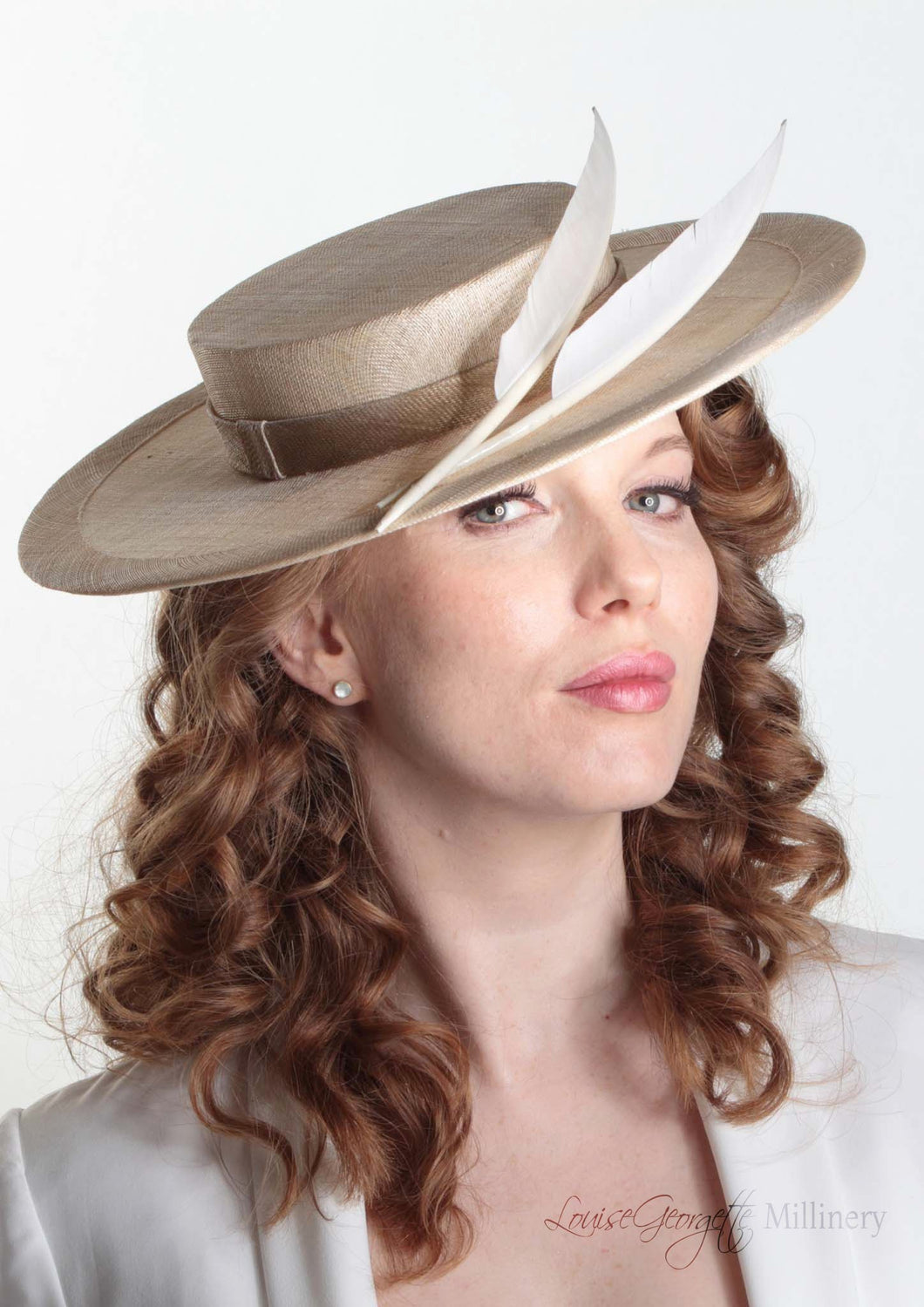 Harper natural and cream boater with two quills. Millinery handmade in London. Side angle view with model.